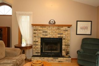 Photo 6: 2 WEST ANDISON Close: Cochrane House for sale : MLS®# C4141938