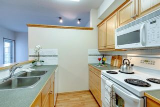Photo 5: 2144 151 Country Village Road NE in Calgary: Country Hills Village Apartment for sale : MLS®# A1147115