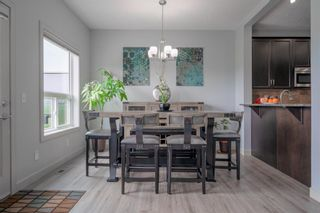 Photo 7: 70 Everhollow Green SW in Calgary: Evergreen Detached for sale : MLS®# A1131033
