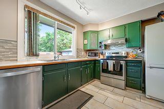 Photo 4: 7511 Hunterburn Hill NW in Calgary: Huntington Hills Detached for sale : MLS®# A1123613