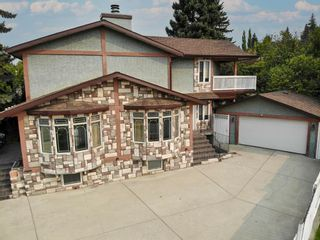 Photo 3: 4 Commerce Street NW in Calgary: Cambrian Heights Detached for sale : MLS®# A1139562
