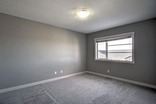 Photo 17: 555 Redstone View NE in Calgary: Redstone Row/Townhouse for sale : MLS®# A1149779