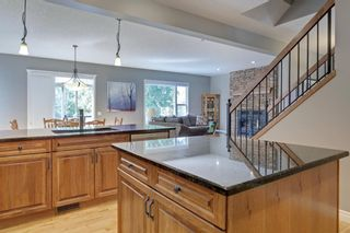 Photo 10: 145 TREMBLANT Place SW in Calgary: Springbank Hill Detached for sale : MLS®# A1024099
