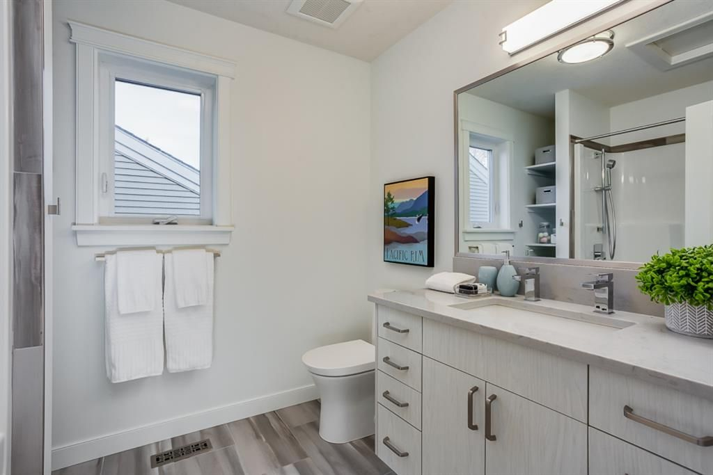 Photo 26: Photos: 219 Somme Manor SW in Calgary: Garrison Woods Detached for sale : MLS®# A1041747