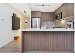 """Photo 14: 312 1152 WINDSOR Mews in Coquitlam: New Horizons Condo for sale in """"Parker House East"""" : MLS®# R2455425"""