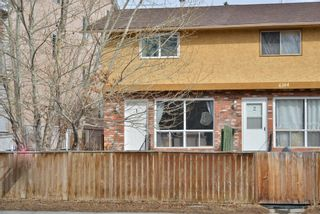 Photo 1: 1 6144 Bowness Road NW in Calgary: Bowness Row/Townhouse for sale : MLS®# A1077373