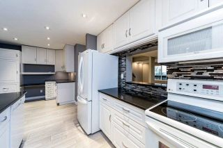 """Main Photo: 1129 LILLOOET Road in North Vancouver: Lynnmour Townhouse for sale in """"LYNNMOUR WEST"""" : MLS®# R2547131"""