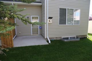 Photo 26: 84 BRIDLERIDGE Manor SW in Calgary: Bridlewood Row/Townhouse for sale : MLS®# A1029938