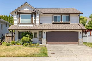 """Photo 1: 35441 CALGARY Avenue in Abbotsford: Abbotsford East House for sale in """"SANDY HILL"""" : MLS®# R2595904"""