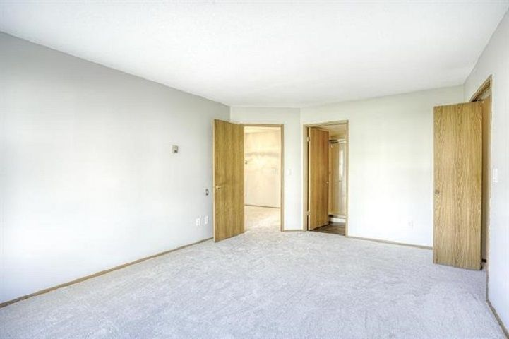 "Photo 8: Photos: 131 7156 121 Street in Surrey: West Newton Townhouse for sale in ""Glenwood Village Scotttsdale"" : MLS®# R2556471"