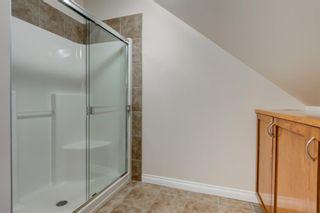 Photo 23: 4111 Garrison Boulevard SW in Calgary: Garrison Woods Row/Townhouse for sale : MLS®# A1108505