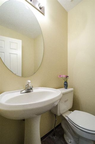 Photo 13: 85 STRATHRIDGE Close SW in Calgary: Strathcona Park Detached for sale : MLS®# A1019965