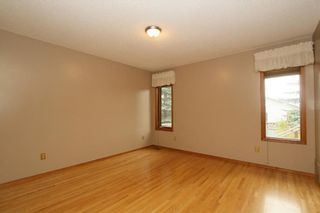Photo 19: 2 WEST ANDISON Close: Cochrane House for sale : MLS®# C4141938