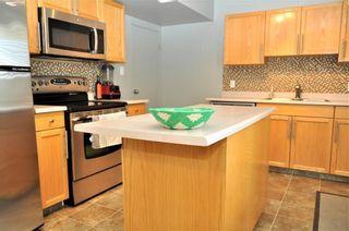 Photo 3: 414 REGAL Park NE in Calgary: Renfrew House for sale : MLS®# C4178136