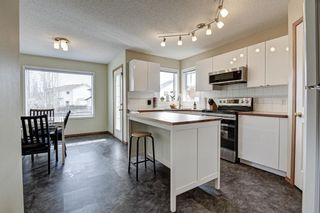 Photo 10: 76 Tuscany Way NW in Calgary: Tuscany Detached for sale : MLS®# A1087131