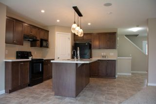 Photo 8: 14 HILLCREST Street SW: Airdrie Detached for sale : MLS®# A1031272