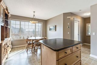 Photo 15: 6 Crystal Shores Cove: Okotoks Row/Townhouse for sale : MLS®# A1080376
