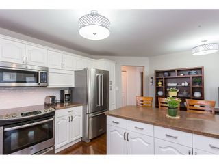 """Photo 5: 304 2626 COUNTESS Street in Abbotsford: Abbotsford West Condo for sale in """"Wedgewood"""" : MLS®# R2394623"""