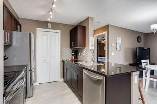 Photo 5: 6207 403 MACKENZIE Way SW: Airdrie Apartment for sale : MLS®# A1037130