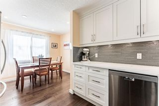 Photo 4: 1441 Ranchlands Road NW in Calgary: Ranchlands Row/Townhouse for sale : MLS®# A1061548