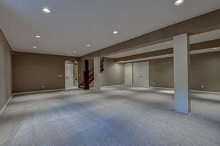 Photo 19: 72 Elysian Crescent SW in Calgary: Springbank Hill Semi Detached for sale : MLS®# A1148526