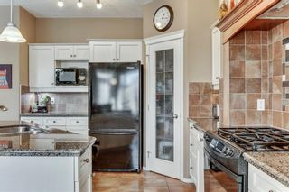 Photo 9: 90 STRATHLEA Crescent SW in Calgary: Strathcona Park Detached for sale : MLS®# C4289258