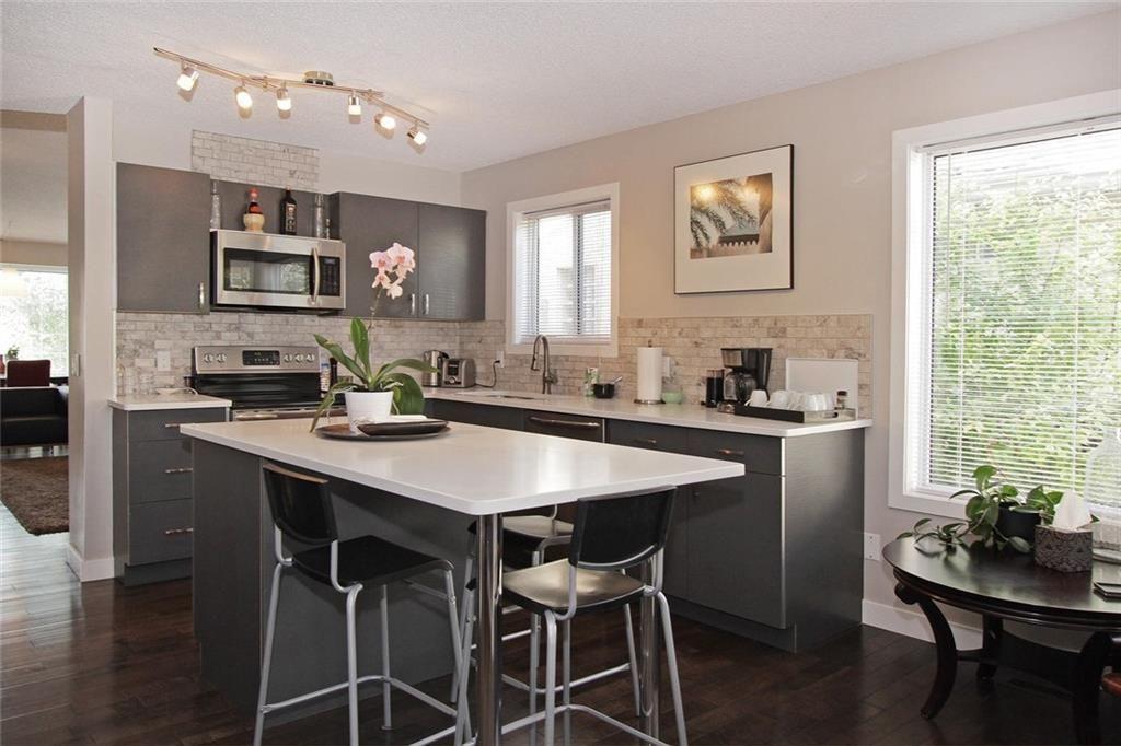 Bright kitchen with nice tile back splash & under mount sink.