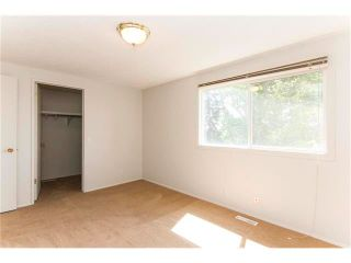 Photo 19: 115 PINESON Place NE in Calgary: Pineridge House for sale : MLS®# C4065261