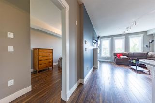 """Photo 4: 210 5665 177B Street in Surrey: Cloverdale BC Condo for sale in """"LINGO"""" (Cloverdale)  : MLS®# R2576920"""