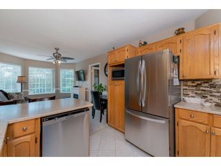 """Photo 8: 208 5375 205 Street in Langley: Langley City Condo for sale in """"GLENMONT PARK"""" : MLS®# R2295267"""