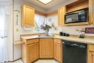 """Photo 7: 201 10584 153 Street in Surrey: Guildford Townhouse for sale in """"GLENWOOD VILLAGE"""" (North Surrey)  : MLS®# R2307414"""