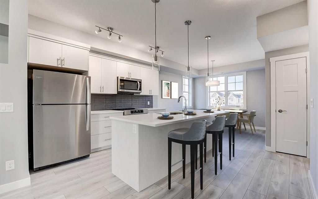 Main Photo: 214 Cranbrook Walk SE in Calgary: Cranston Row/Townhouse for sale : MLS®# A1112034