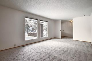 Photo 4: 762 Woodpark Road SW in Calgary: Woodlands Detached for sale : MLS®# A1048869