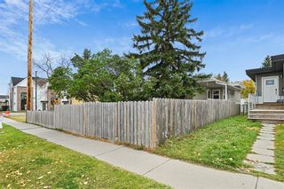 Photo 3: 2107 50 Avenue SW in Calgary: North Glenmore Park Semi Detached for sale : MLS®# A1151059