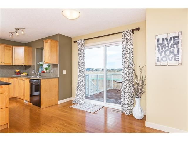 Photo 9: Photos: 664 LUXSTONE Landing SW: Airdrie House for sale : MLS®# C4106944