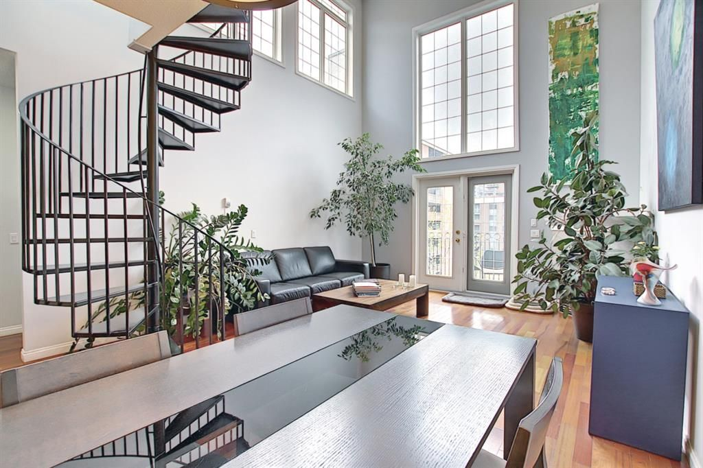 The city views, the private rooftop patio, the inner-city lifestyle, the 20 ft soaring ceilings and curved spiral staircase - this massive penthouse loft at The Conservatory has it all, and it's yours for the taking!
