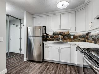 Photo 7: 109 3606 Erlton Court SW in Calgary: Parkhill Apartment for sale : MLS®# A1136859
