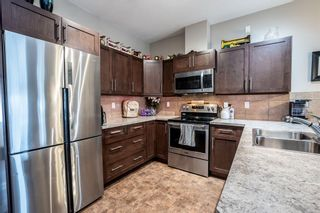 Photo 3: 44 Sunrise Place NE: High River Row/Townhouse for sale : MLS®# A1059661