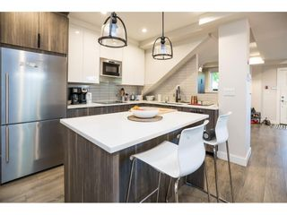 """Photo 14: 2 NANAIMO Street in Vancouver: Hastings Sunrise Townhouse for sale in """"Nanaimo West"""" (Vancouver East)  : MLS®# R2582479"""