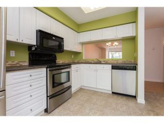 """Photo 1: 58 13706 74TH Avenue in Surrey: East Newton Townhouse for sale in """"Ashlea Gate"""" : MLS®# F1448974"""