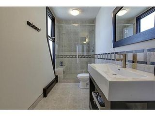 Photo 12: 19 828 COACH BLUFF Crescent SW in Calgary: 2 and Half Storey for sale : MLS®# C3563691