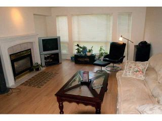 """Photo 2: 11 1255 RIVERSIDE Drive in Port Coquitlam: Riverwood Townhouse for sale in """"RIVERWOOD GREEN"""" : MLS®# V896489"""