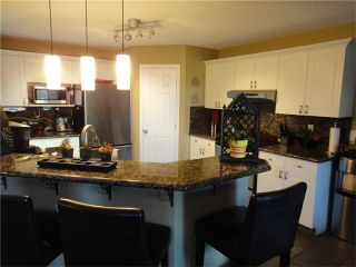 Photo 5: 266 BRIDLEWOOD Circle SW in Calgary: Bridlewood House for sale : MLS®# C4031965