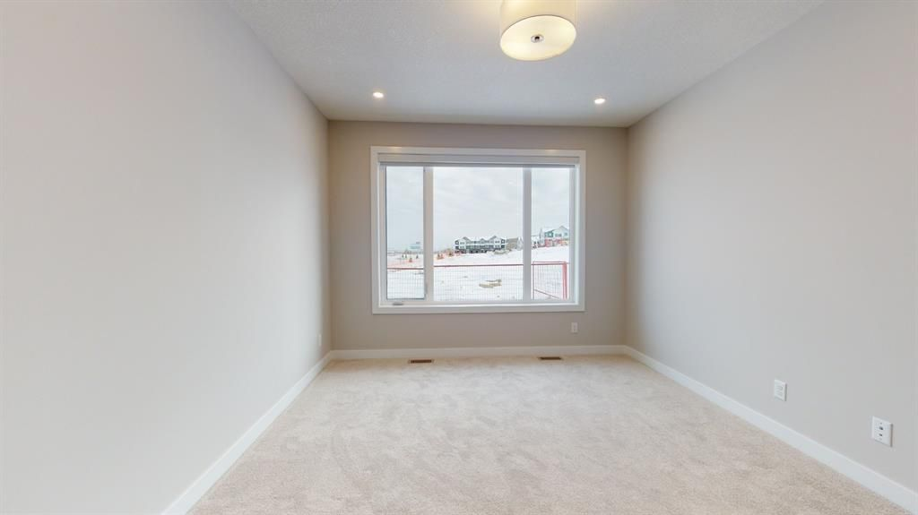 Photo 26: Photos: 38 Crestridge Bay SW in Calgary: Crestmont Row/Townhouse for sale : MLS®# A1073636