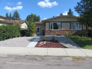 Photo 1: 357 Woodvale Crescent SW in Calgary: Woodlands Semi Detached for sale : MLS®# A1135631