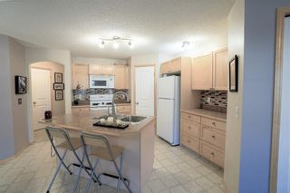 Photo 8: 104 3 EVERRIDGE Square SW in Calgary: Evergreen Row/Townhouse for sale : MLS®# A1143635