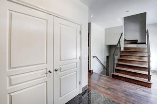 Photo 5: 29 Somme Boulevard SW in Calgary: Garrison Woods Row/Townhouse for sale : MLS®# A1129180