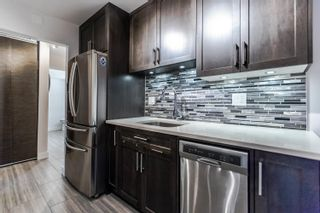 "Photo 3: 103 1935 W 1ST Avenue in Vancouver: Kitsilano Condo for sale in ""KINGSTON GARDENS"" (Vancouver West)  : MLS®# R2249409"