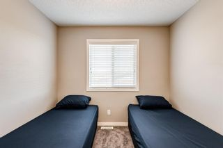 Photo 23: 504 Panatella Walk NW in Calgary: Panorama Hills Row/Townhouse for sale : MLS®# A1153133