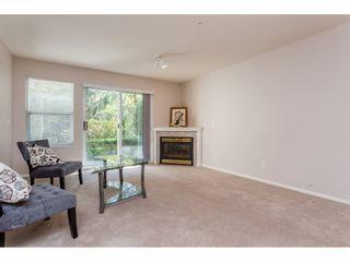 Photo 2: 114 27358 32 Avenue in Langley: Condo  : MLS®# R2112744